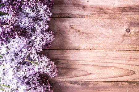 lilacs: Lilacs on wooden backgorund Stock Photo
