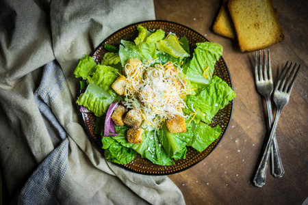 chicken caesar salad: Caesar salad on rustic background