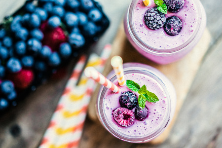 berry: Fresh berry smoothies on mason jars