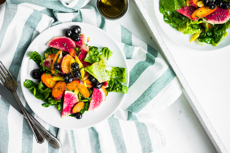 yellow: Summer salad with vegetables and berries