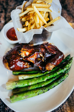Barbecue chicken with asparagus and french fries Stok Fotoğraf