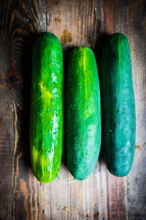 cucumbers: Cucumbers on wooden background