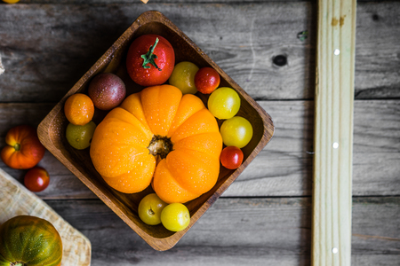 heirloom: Colorful heirloom tomatoes on rustic wooden background