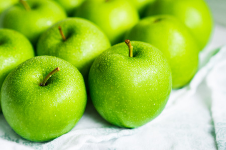 green apples: Bright green apples on white napkin