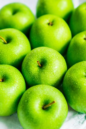 white napkin: Bright green apples on white napkin