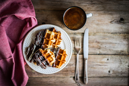 Belgian waffles with chocolate on rustic wooden background 免版税图像 - 46910189