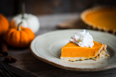 Pumpkin pie on rustic wooden background Stock Photo