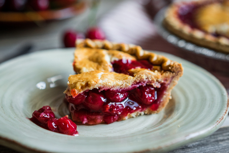 Homemade cherry pie on rustic background