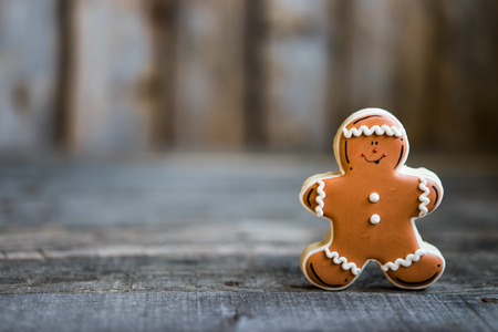 gingerbread man: Gingerbread man on rustic background Stock Photo