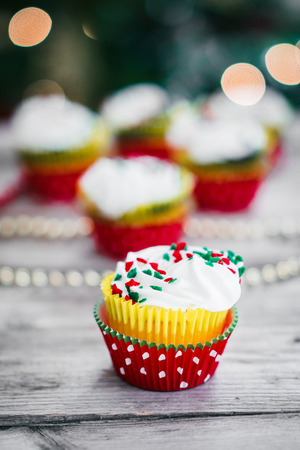christmas cupcakes: Christmas cupcakes on wooden background Stock Photo