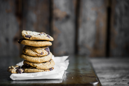 rustic food: Chocolate chip cookies on rustic background
