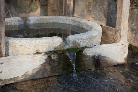 dissolved: Traditional mineral spring in Korea rising naturally from the underground aquifer for a continuous supply of water rich in dissolved minerals