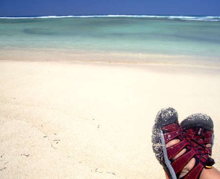 Person wearing red sandals enjoying tropical, sandy beach.  Feet visible only. Stock Photo - 7215465