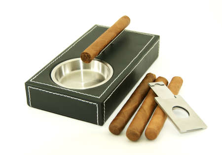cutter: Cigar ashtray with cigars and cutter