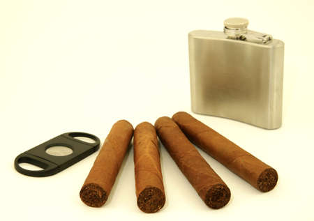 cutter: Close up of  4 cigars, cigar cutter and hip flask