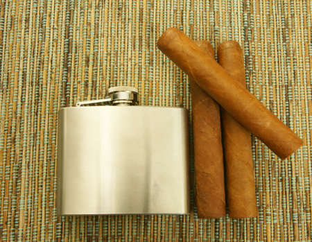 chrome man: Close up of  cigars and hip flask