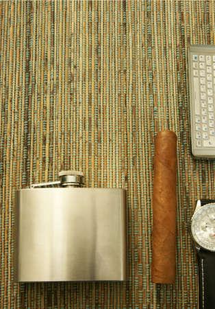 chrome man: Close up of  cigar, hip flask, wristwatch and phone
