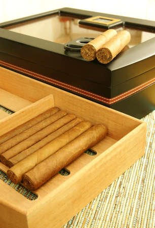 Cuban cigars, black humidor, cigar cutter