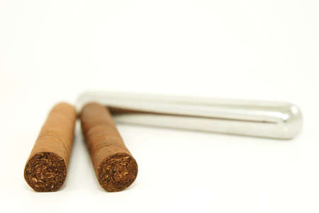 Close-up of two cigars and  a stainless steel tube container Imagens