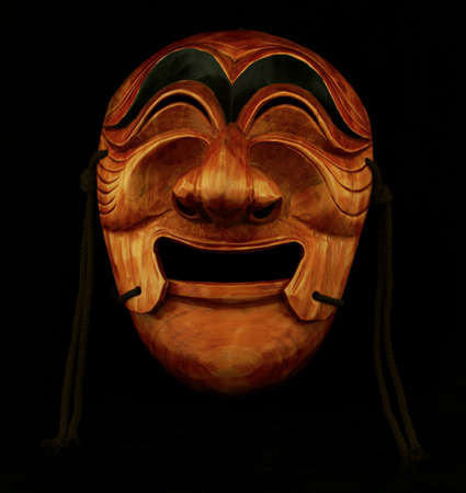 Korean traditional male wooden mask on a black background Stock fotó