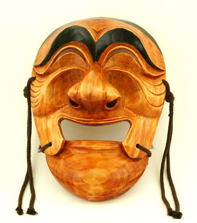 souvenir traditional: Korean traditional male wooden mask on a white background Stock Photo