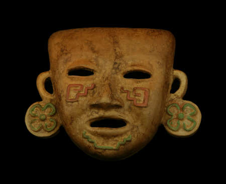 mayan culture: Mayan mask on a black background Stock Photo