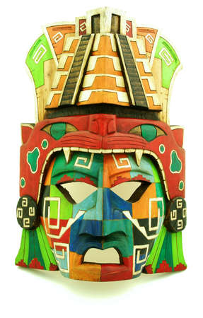 Wooden Mayan mask on a white background photo