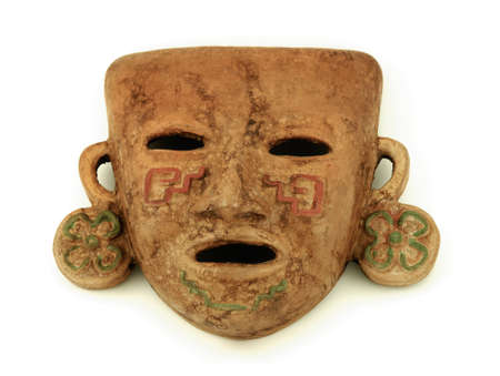 mayan culture: Mayan mask on a white background Stock Photo