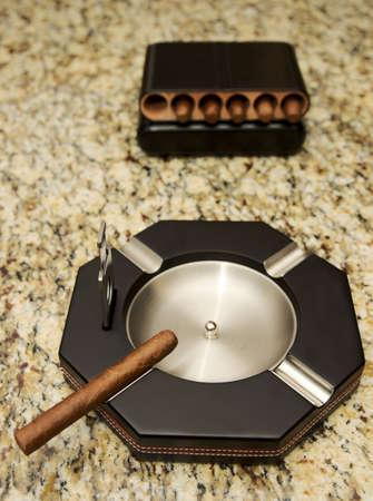 Cigar ashtray with one cigar ready to smoke