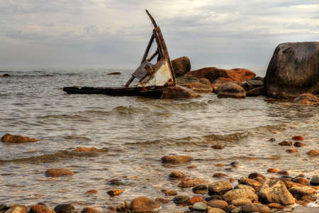 beached: Shipwreck washed up on a rocky Lake Huron coastline  Sanilac County Park  Lexington, Michigan  Stock Photo
