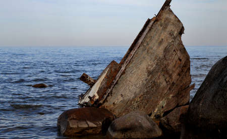 Hull of a wooden sailboat beached on the coast of Lake Huron  Sanilac County Park  Lexington, Michigan  photo