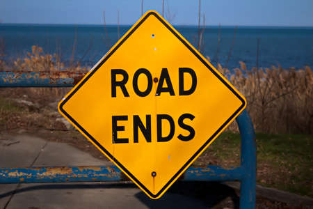 Road Ends  Warning to drivers as the road abruptly ends at the beautiful shores of Lake Huron  Port Sanilac, Michigan Stock Photo - 20245738