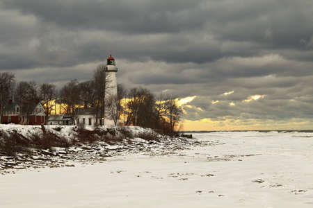 The Guardian   Point Aux Barques Lighthouse stands guard over a wintry Great Lakes shoreline  Lighthouse County Park  Port Hope, Michigan  Stock Photo - 20245740