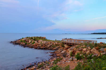 huron: Rocky Great Lakes coastline with a wooden bridge  Lighthouse County Park  Port Hope, Michigan