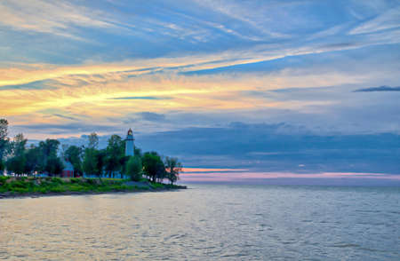 huron: Lake Huron horizon with Point Aux Barques Lighthouse in the background Stock Photo