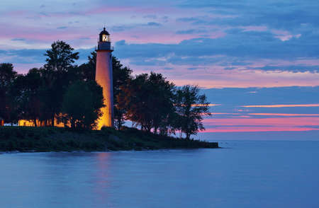 Point Aux Barques Lighthouse stands guard over the Lake Huron shoreline  photo