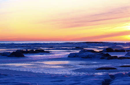 january sunrise: Winter Sunrise  A frigid January sunrise over an arctic Lake Huron shoreline  Lexington County Park  Lexington, Michigan