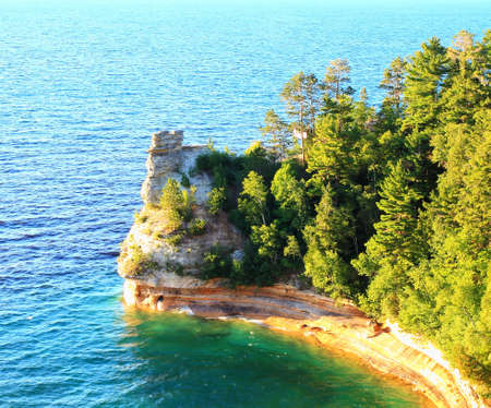 pictured: Miners Castle geological formation jutting into Lake Superior  Pictured Rocks National Lakeshore  Munsing, Michigan  Stock Photo