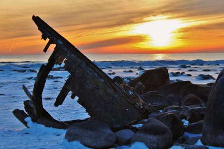 Shipwreck beached on a winter shore   Lexington County Park  Lexington, Michigan