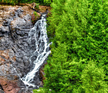 eagle falls: Gorgeous Eagle Falls cascades down the cliff face on it s was to Lake Superior  Located in Eagle Harbor, Michigan  Stock Photo