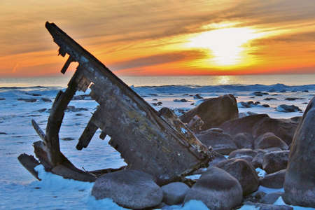 beached: Unknown shipwreck beached on a lonely winter shore   Lexington County Park  Lexington, Michigan  Stock Photo