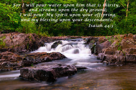 A waterfall flows gently through the great north woods, on it s way to Lake Superior with biblical verse text