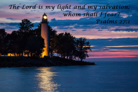 The Lord is my light and salvation  Lighthouse reflecting over the water with quote from the book of Psalms  Lighthouse County Park  Port Hope, Michigan   photo