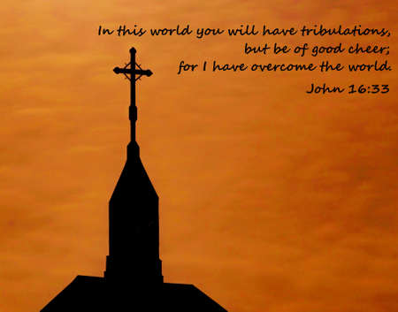 Church steeple at sunrise with verse from the Book of John regarding trials and tribulations  photo