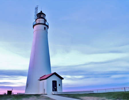 huron: Fort Gratiot Lighthouse at twilight  The Fort Gratiot Lighthouse is the oldest lighthouse in the state of Michigan  Lighthouse Park  Port Huron, Michigan   Stock Photo