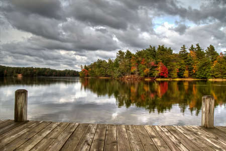 Dock reflections on a gorgeous lake with a forested shoreline in the background  Ludington State Park  Ludington, Michigan