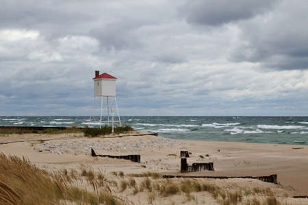 Watchtower looks over a storm tossed Lake Michigan  Ludington State Park  Ludington, Michigan  photo