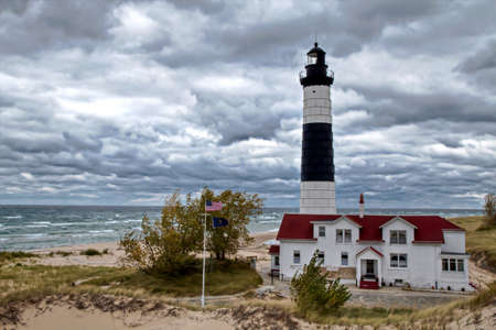 Lighthouse is a beacon of hope on a remote windswept beach  Big Sable Point Lighthouse  Ludington State Park  Ludington, Michigan  photo
