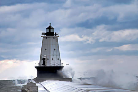 ludington: Waves crash onto the Ludington Lightouse pier  Ludington Waterfront Municipal Park  Ludington, Michigan   Stock Photo