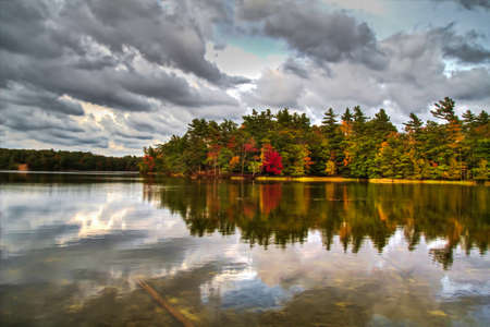 Autumn colors mirrored in the tranquil waters of Lost Lake  Ludington State Park  Ludington, Michigan   photo